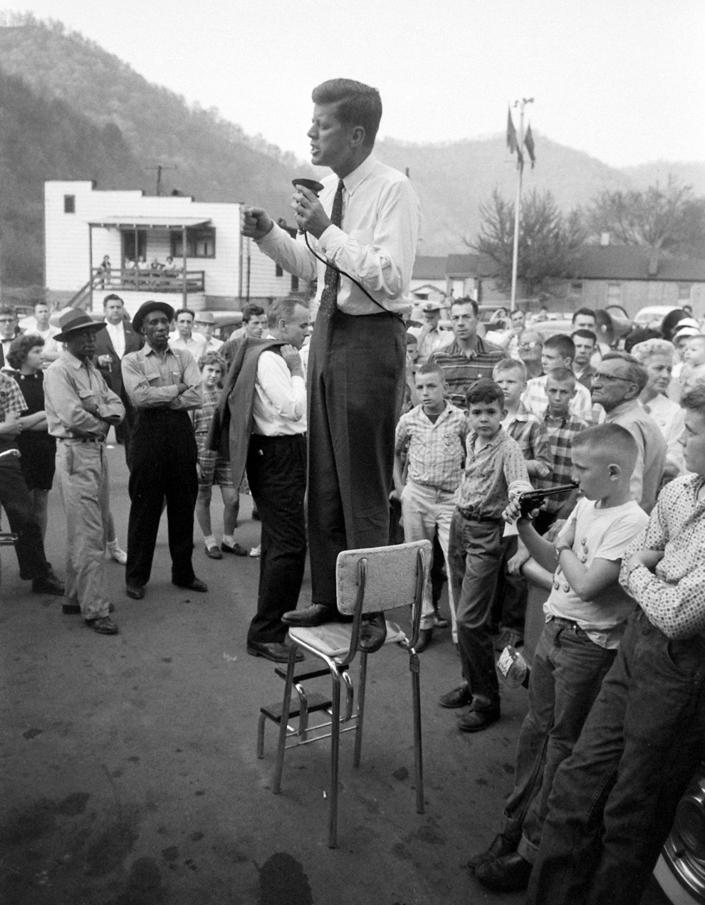 JFK on kitchen stool addressing crowd