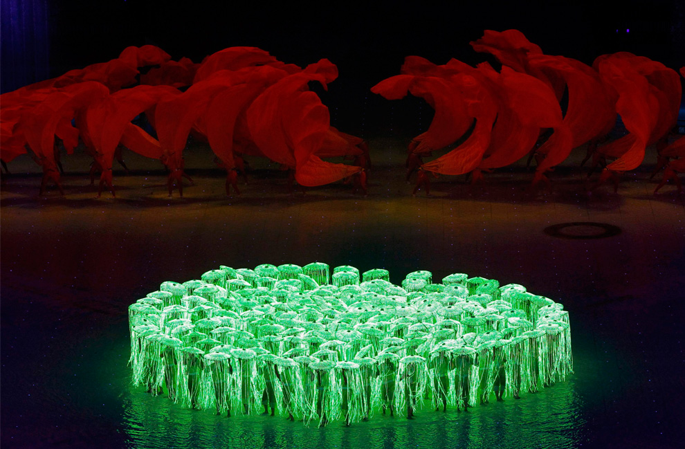 Illuminated performers take part in the opening ceremony of the 16th Asian Games on November 12, 2010. (REUTERS/Mick Tsikas)