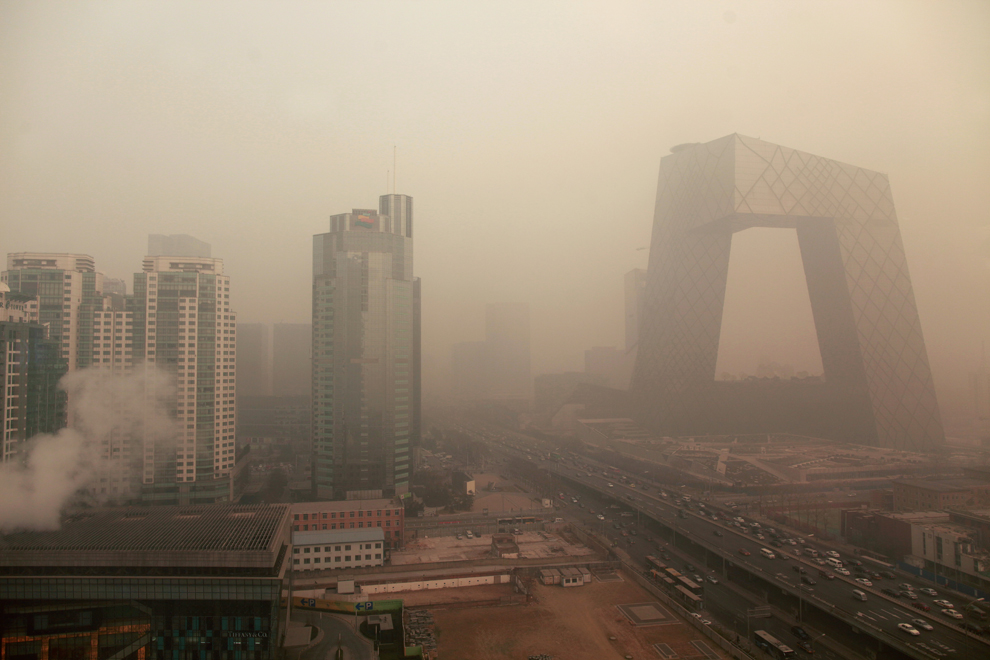 Heavy pollution surrounds the China Central Television headquarters building (right) in Beijing on January 18, 2012. The US embassy, which has its own pollution measuring system and which rates anything over 150 as unhealthy, was showing an index of 403, or 'hazardous'. (Ed Jones/AFP/Getty Images) #