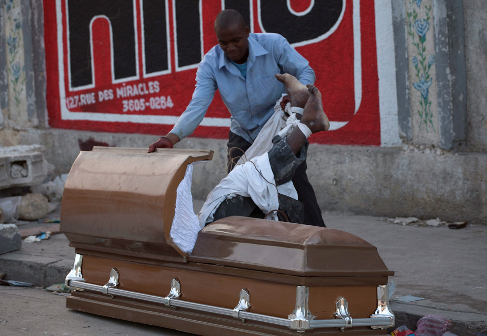 Dead Embalmed Bodies In Coffin http://www.boston.com/bigpicture/2010/01/haiti_six_days_later.html
