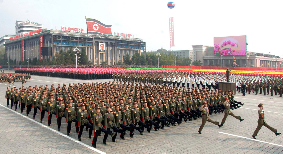 north korean army parade. North Koreans take part in a