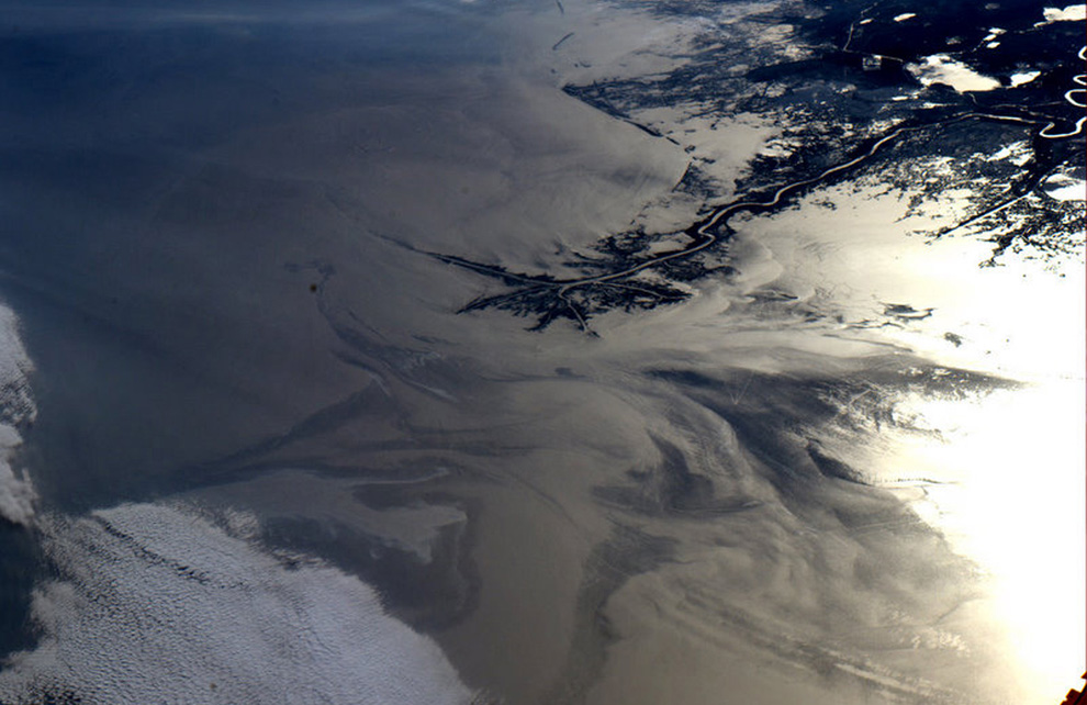 NASA photo from the International Space Station, showing the giant oil slick approaching the Mississippi Delta (top right)