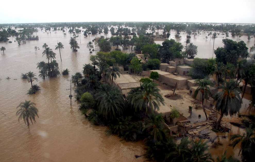 An aerial view of floodwater covering the land as far as the eye can see, around Taunsa near Multan, Pakistan, Sunday, Aug. 1, 2010. (AP Photo/Khalid Tanveer)