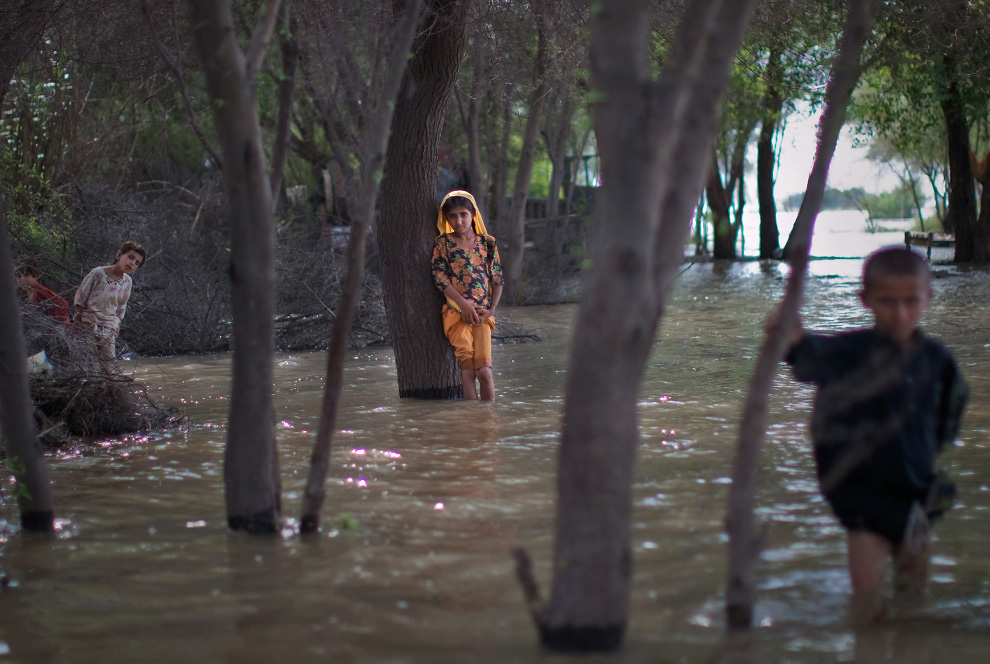 Children, whose families have declined to be rescued, wade in rising flood waters on August 6, 2010 in the village of Panu Akil, near Sukkur, Pakistan. Rescue workers and armed forces continued rescue operations evacuating thousands in Pakistan's heartland province of Sindh. (Daniel Berehulak/Getty Images)