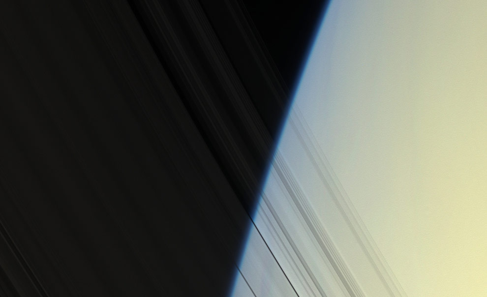Cassini peers through Saturn's delicate, translucent inner C ring to see the diffuse yellow-blue limb of Saturn's atmosphere. The image was taken on April 25, 2008 at a distance of approximately 1.5 million km (913,000 mi) from Saturn. Image scale is 8 km (5 mi) per pixel. (NASA/JPL/SSI)