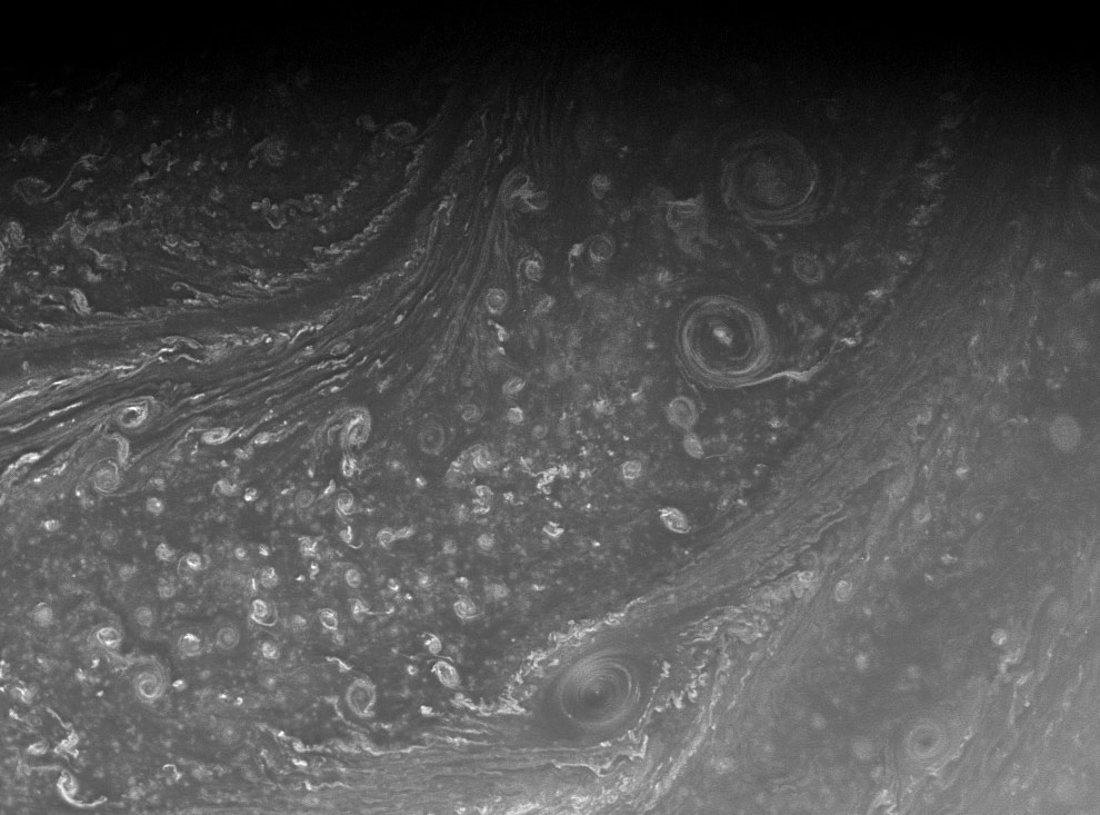 Saturn's high north is a seething cauldron of activity filled with roiling cloud bands and swirling vortices. A corner of the north polar hexagon is seen at upper left. The image was taken on Aug. 25, 2008 at a distance of approximately 541,000 km (336,000 mi) from Saturn. Image scale is 29 km (18 mi) per pixel. (NASA/JPL/SSI)