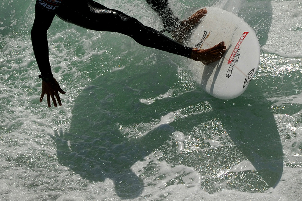 Luke Davis of the US competes in his heat during the US Open of Surfing at Huntington Beach, California on August 4, 2010. The event celebrates its 51st year beside the historic Huntington Pier which is considered the birthplace of California's surfing culture. (MARK RALSTON/AFP)