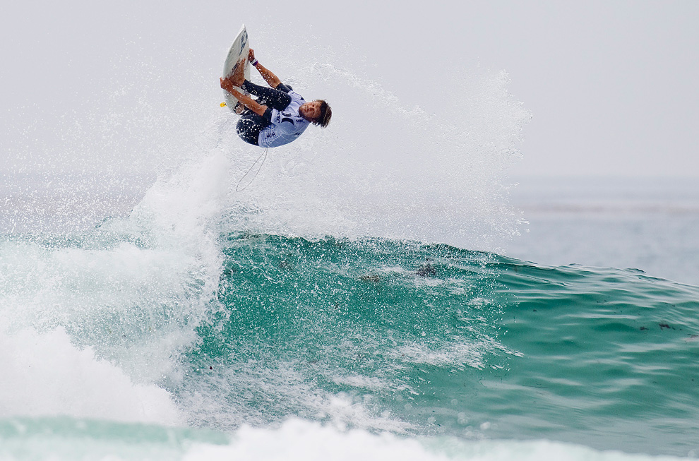 Dane Reynolds, of Venture Beach, California, flies over a wave during his round 3 heat in the The Hurley Pro surfing competition in San Clemente, California. (AP Photo/ASP, Kirstin Scholtz)