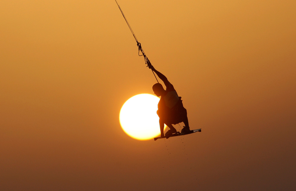 An Israeli man kitesurfs in the Mediterranean sea at the southern Israeli city of Ashkelon September 27, 2010. (REUTERS/Amir Cohen)