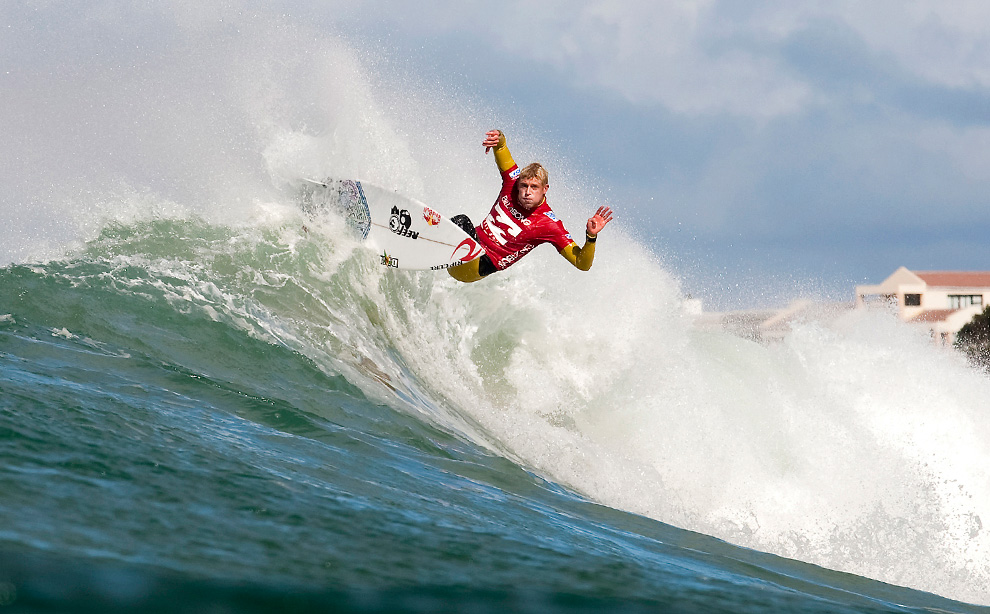Mick Fanning, of Australia, competes in the Billabong Pro Jeffreys Bay surfing competition in Jeffreys Bay, South Africa on Thursday, July 15, 2010. (AP Photo/ASP, Kelly Cestari)