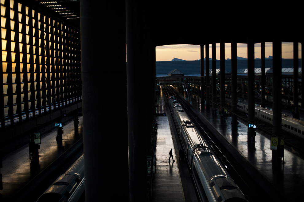 A worker walks through Madrid Atocha train station during a general strike in Madrid on November 14, 2012. (Daniel Ochoa de Olza/Associated Press)