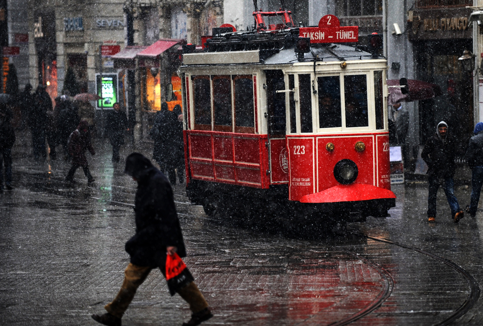 Snow falls on Istiklal Avenue in Istanbul on January 7, 2013. (Bulent Kilic//AFP/Getty Images)