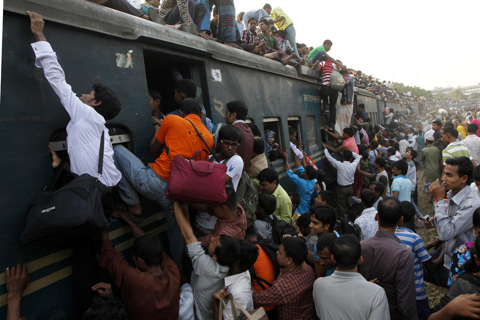 Passengers board a train as they rush home to be with their families in remote villages ahead of the Muslim festival of Eid al-Adha, in Dhaka on October 25, 2012. (Stringer/AFP/Getty Images)