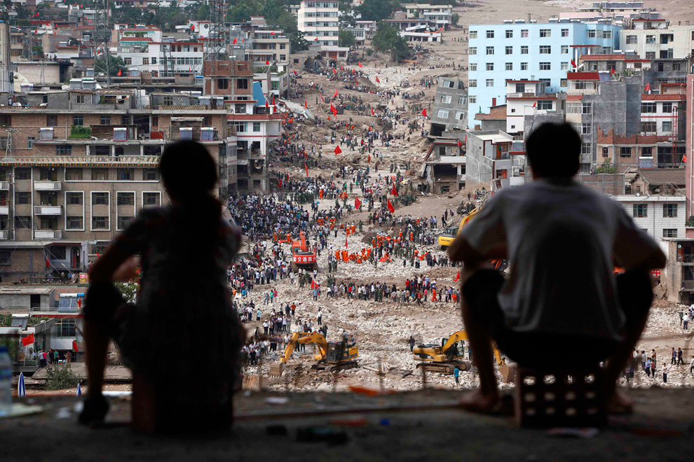 The landslide-hit town of Zhouqu in Gannan Tibetan Autonomous Prefecture, Gansu Province, China on August 9, 2010. Chinese rescuers armed with little more than shovels and hoes hunted for survivors of a huge mudslide, as relatives of the missing trekked into the disaster zone to look for their loved ones. (REUTERS/Aly Song)