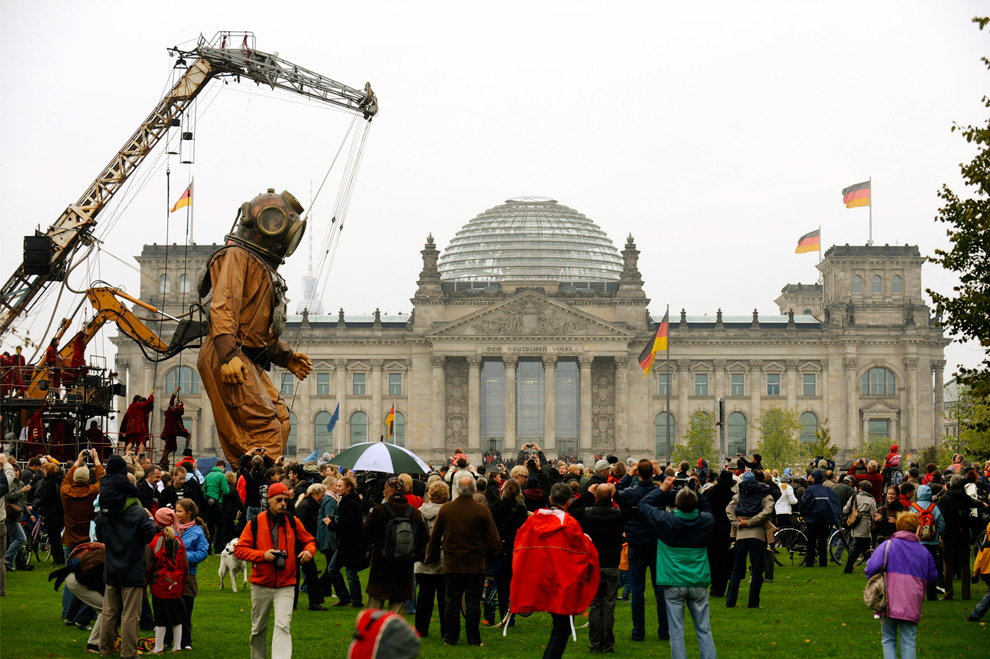 The Big Giant makes his way past the Reichstag (Germanys pariamentary building) in Berlin on October 3, 2009. (AXEL SCHMIDT/AFP/Getty Images)