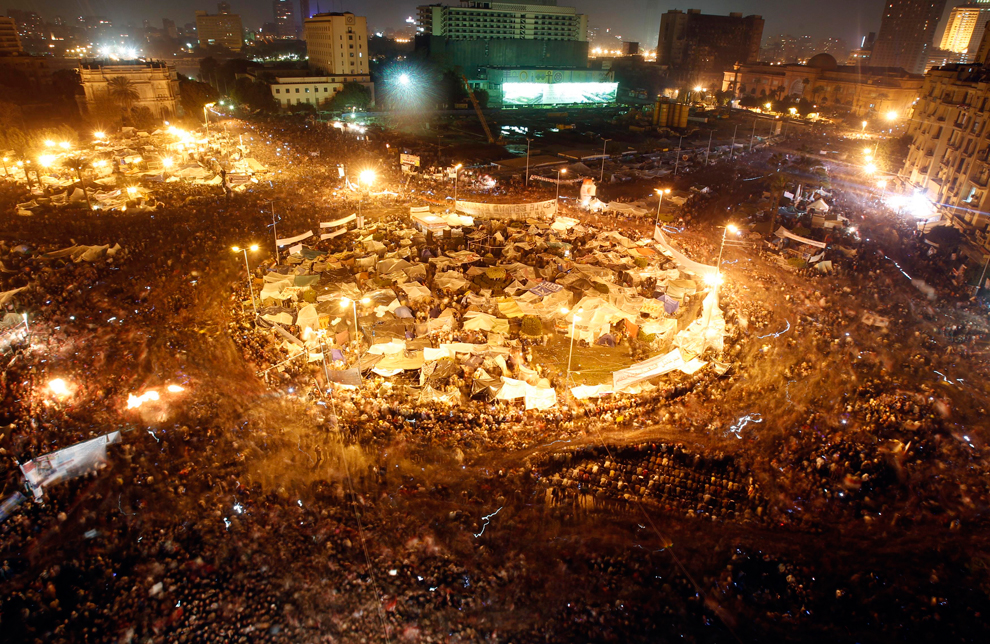 8 Anti-government protesters celebrate inside Tahrir Square after the announcement that Egyptian President Hosni Mubarak had resigned on February 11, 2011. (Amr Abdallah Dalsh/Reuters)